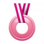 真ん中に穴の空いたピンク色のメダルイラスト